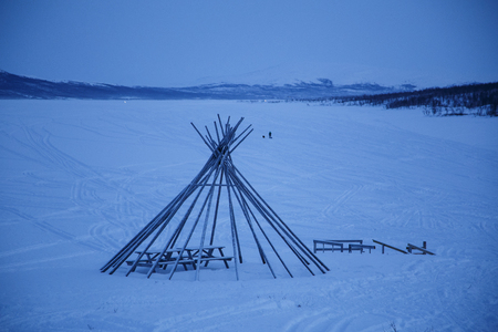 Wigwam in winter frosen lake in north of Finland Stock Photo