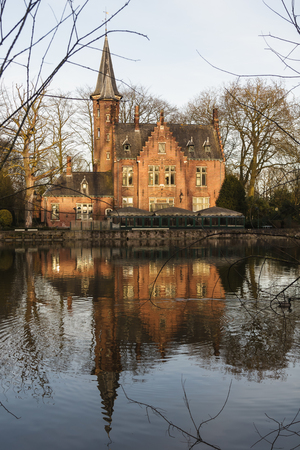 Beautiful house with reflection on the channel Brugge,Belgium Stock Photo