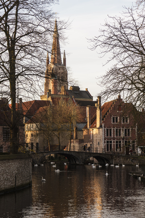 Beautiful church with reflection on the channel Brugge,Belgium