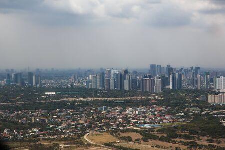 Manila from the air, capital of the philippines Redakční