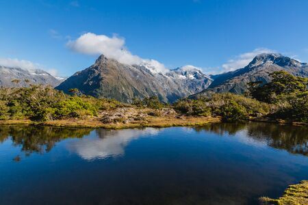 Mountain lake and clouds , Key Summit Trail, Routeburn Track, New Zealand Stock Photo