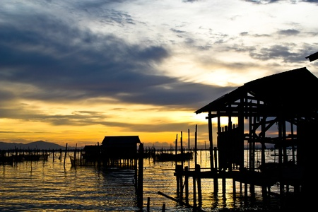 fisherman hut at the evening, South of Thailand Stock Photo - 12464377