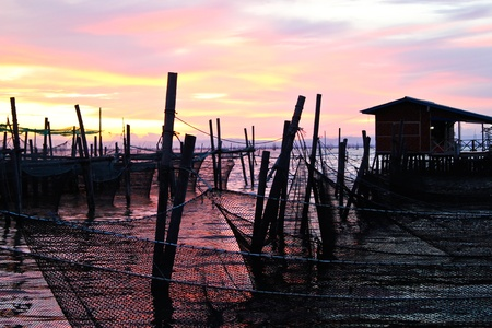 floating basket and fisherman hut, South of Thailand Stock Photo - 12464380