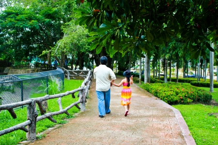 Thai girl holding her father by hand Stock Photo - 12464383