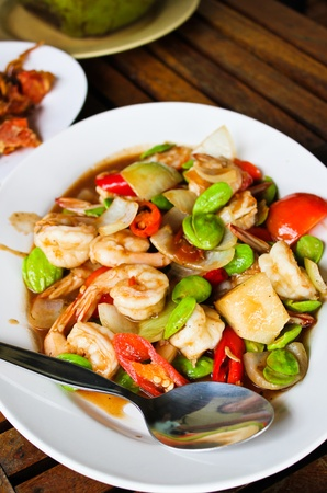 fried shrimp with red chillies,tomatoes and stinky beans Stock Photo - 12786522