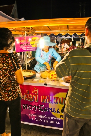Thai woman selling the sweetmeat at night market Stock Photo - 12786625