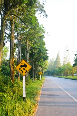 Curved Road Traffic Sign on a road  Stock Photo