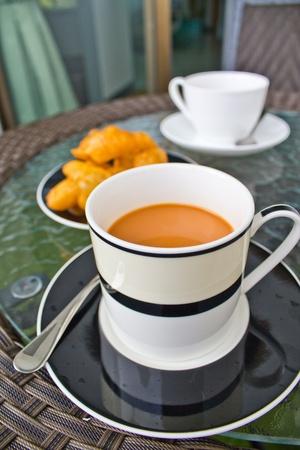 Hot tea and deep-fried dough stick Stock Photo