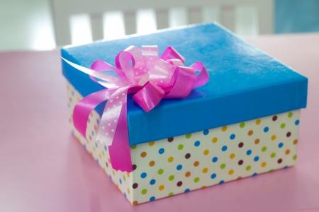 Single gift box with pink ribbon  Stock Photo
