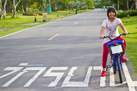Asian girl riding bicycle photo