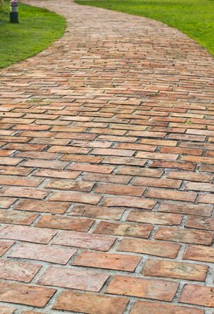 A curved brick path photo
