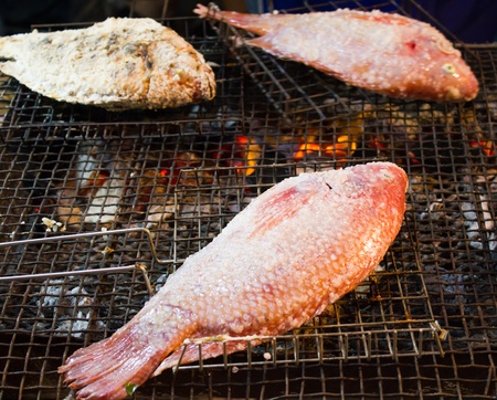 oreochromis niloticus: grilled fishes Stock Photo