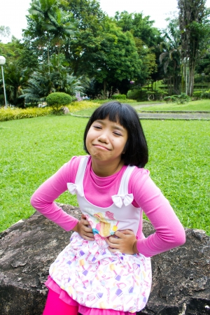 Asian young girl have a stomachache photo