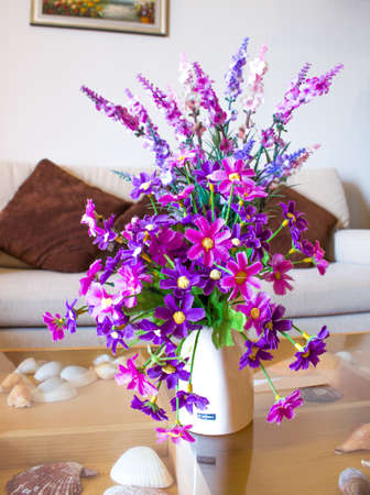 artificial flower: artificial flower in white vase
