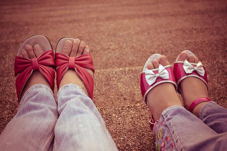 hearthside: mom sitting beside her daughter