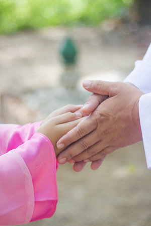 Muslim dad and daughter greeting to each other