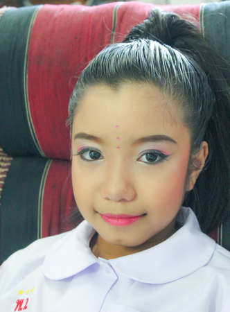 thai dancing: Asian kid with make up on face for Thai dancing
