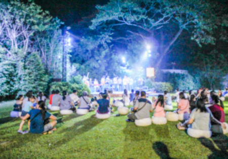 traditional festivals: blur photo of plople listening outdoor concert in the garden at Hua hin, Thailand Stock Photo