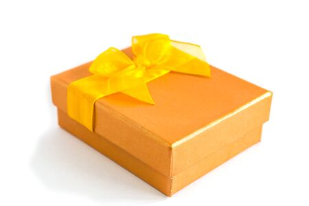 gold gift box: gold gift box with yellow ribbbon isolated on white background