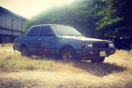 rusty car: old rusty car in retro filter Stock Photo