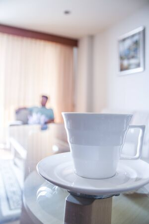 dinning room: white coffee cup on table in the dinning room