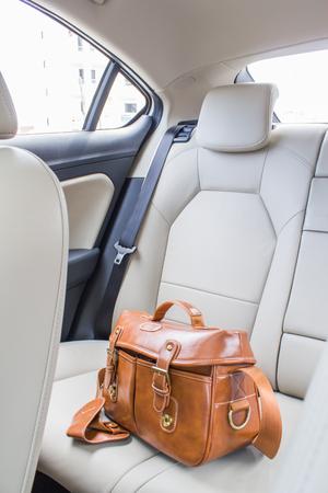 leather bag: vintage leather bag in car