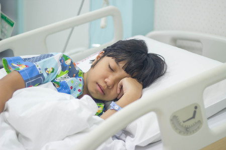gril: sick gril in hospital bed Stock Photo