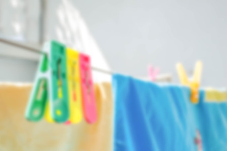 pegs: blur photo de focused of colorful clothes pegs hanging
