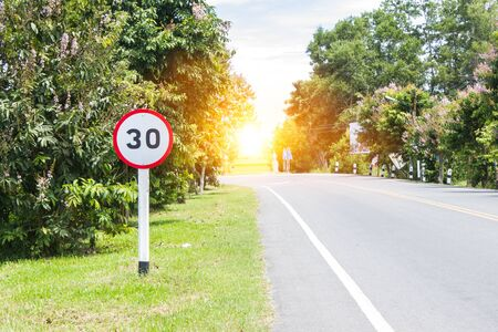 Round speed limit road sign on the road Imagens