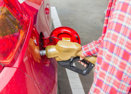 Man fills up car with a gasoline at gas station Stock Photo
