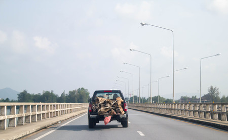 pick up truck: wood on pick up truck on the road of Thailand Stock Photo