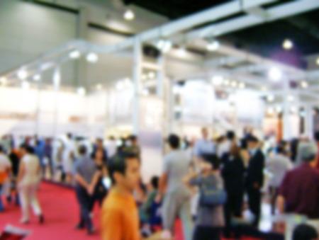 visitors: blur photo of visitors at motor show Stock Photo