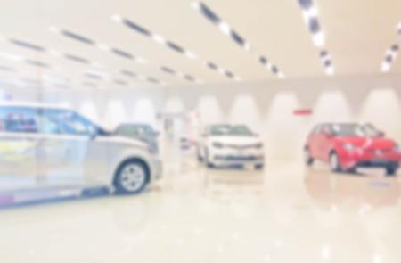 blur photo of car showroom Stock Photo