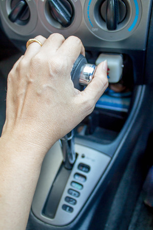 shifting: driver hand shifting the automatic gear stick