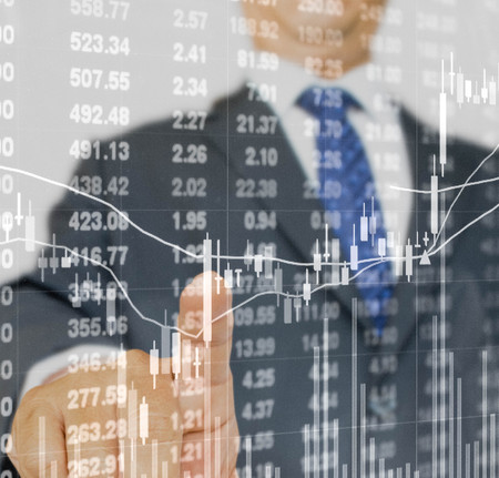 double exposure of businessman pressing on stock price