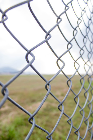link up: close up photo of metal chain link fence