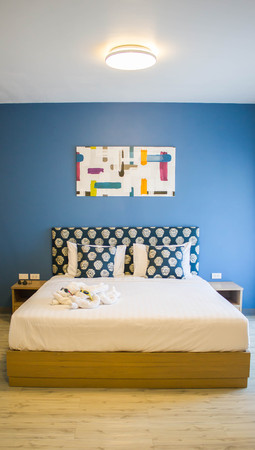 bedroom wall: modern bedroom with blue wall and wood floor Stock Photo
