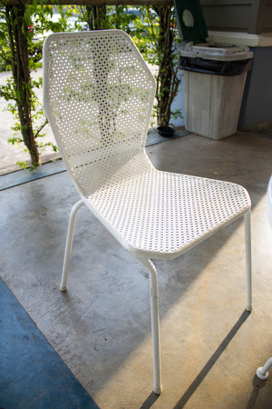 white metal chair with  sunlight
