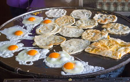 Rotee : traditional Muslim food on hot pan with fry eggs Stock Photo