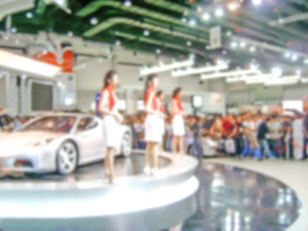 blurred photo of car presenter Motor show in Thailand : for background use