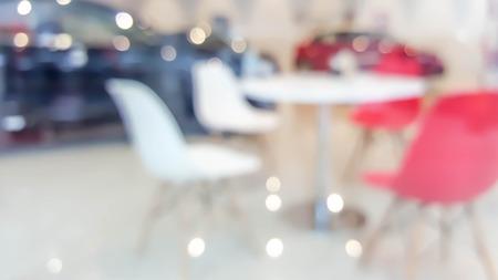 de focused: blur photo de focused of table and chair in car showroom