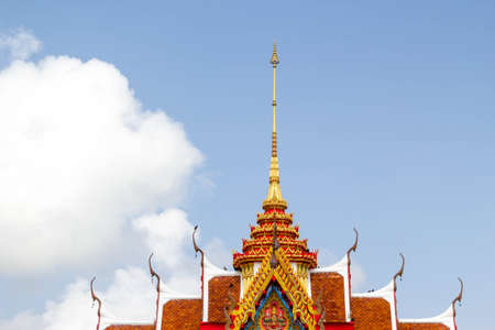 traditional thai style temple in thailand on blue sky and white cloud background
