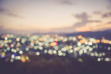 de focus: abstract blur bokeh of night light city at sunset