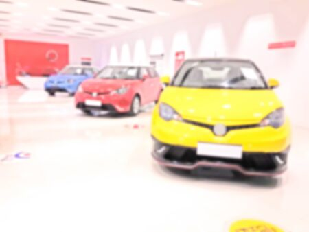blur photo of car showroom Stock Photo