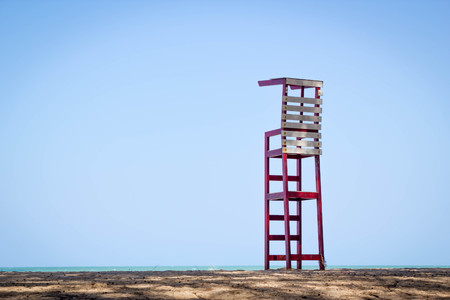 life guard stand: life guard chair on the beach with blue sky background Stock Photo