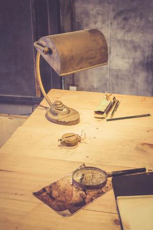 vintage lamp on the desk of archaeologist Banco de Imagens