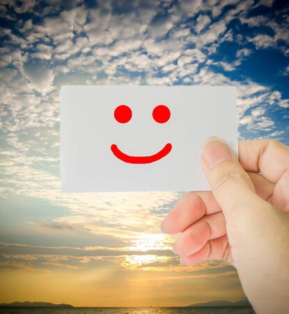 beatuful: smiling face on white paper with beatuful sky background