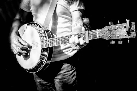 musician playing banjo in black and white filter photo