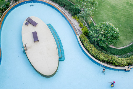gree: people in swimming pool with gree garden look from top