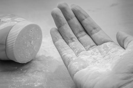 talcum: white talcum powder on the wood floor in black and white